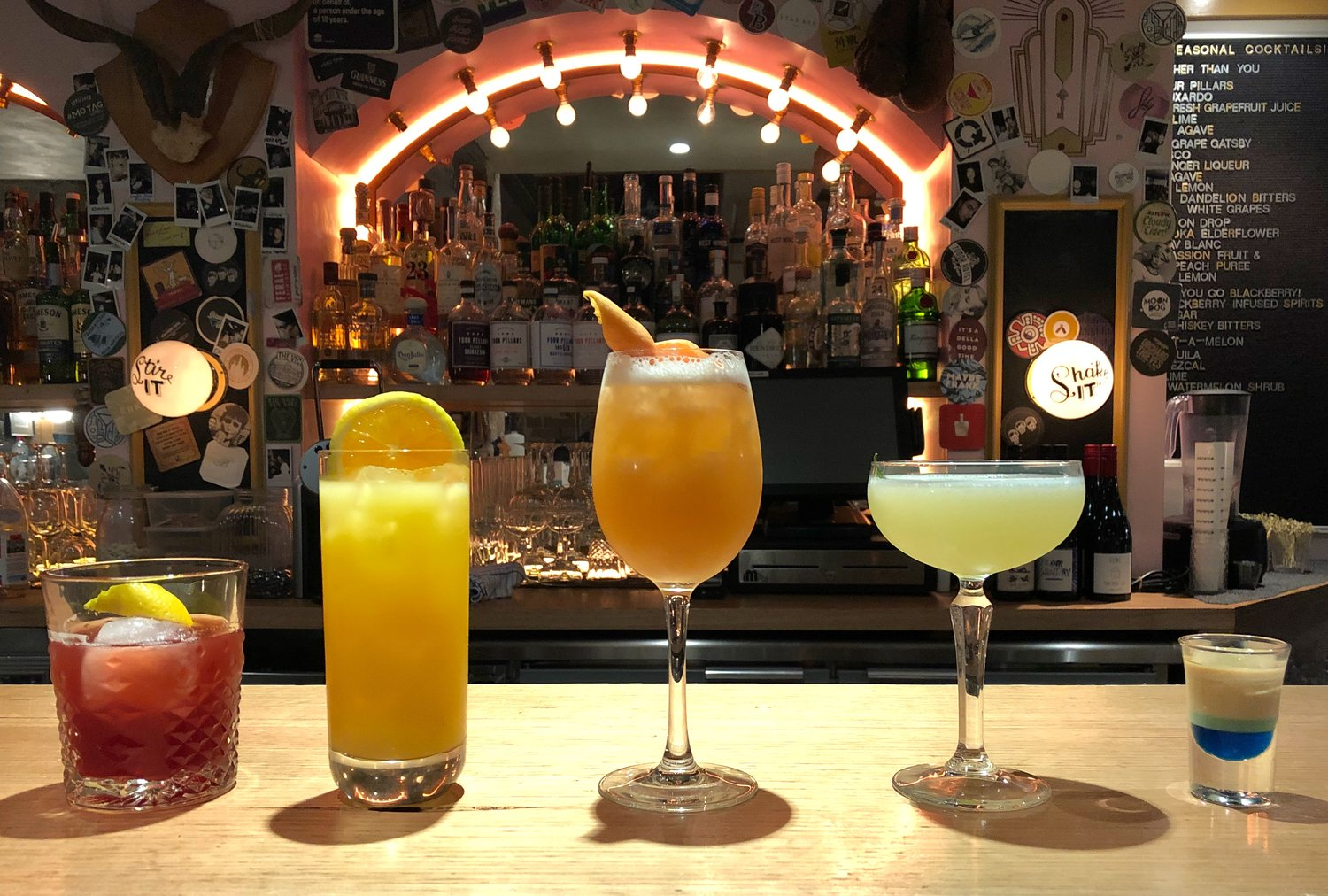 5 cocktails, each a different colour symbolising an arched rainbow