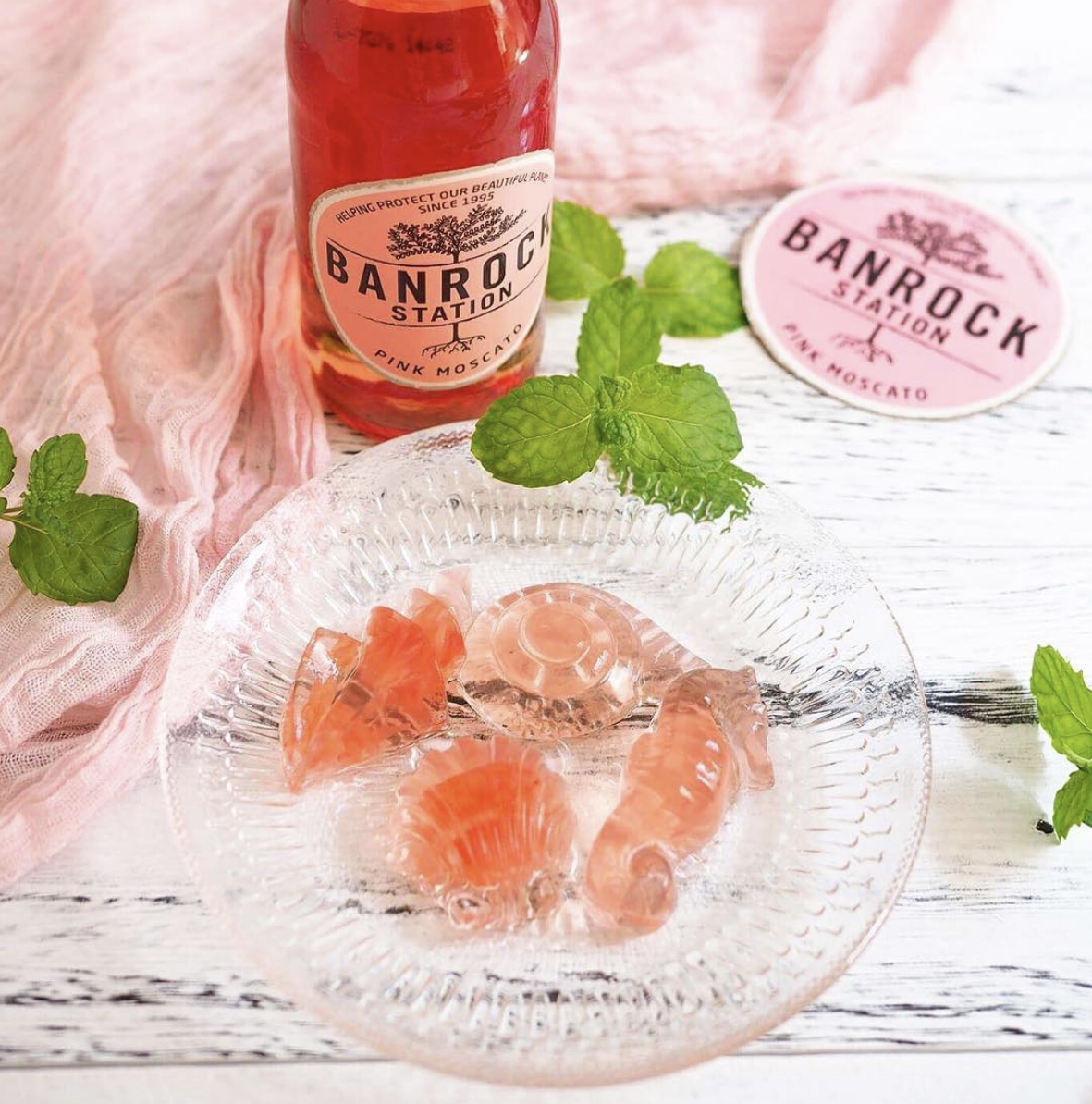 Pink moscato and grapefruit jellies on glass plate