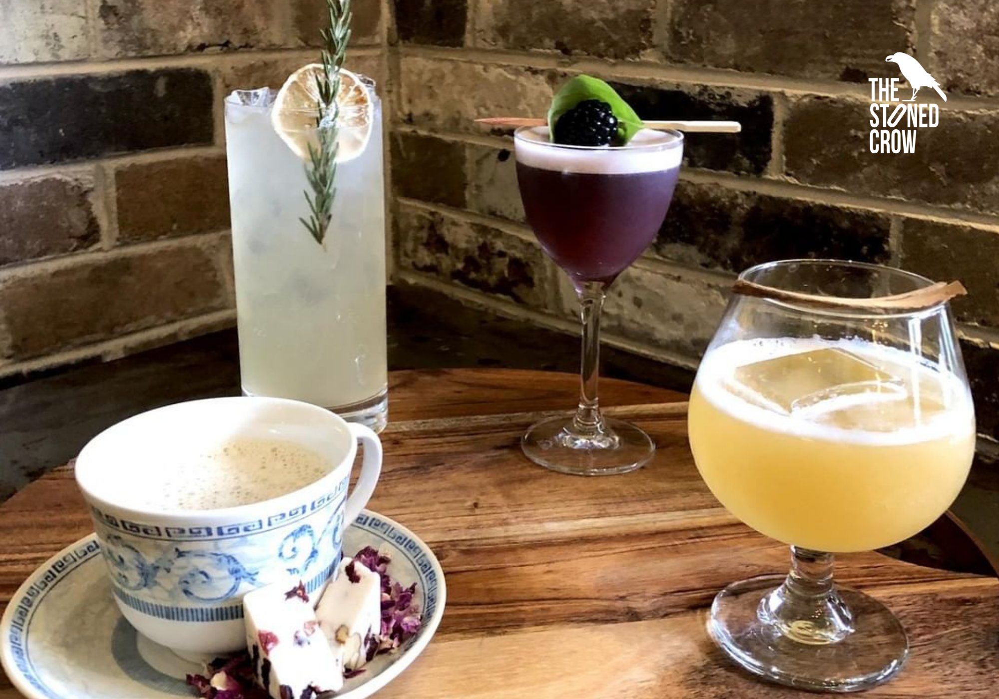 Four different winter-themed cocktails in different shaped glasses