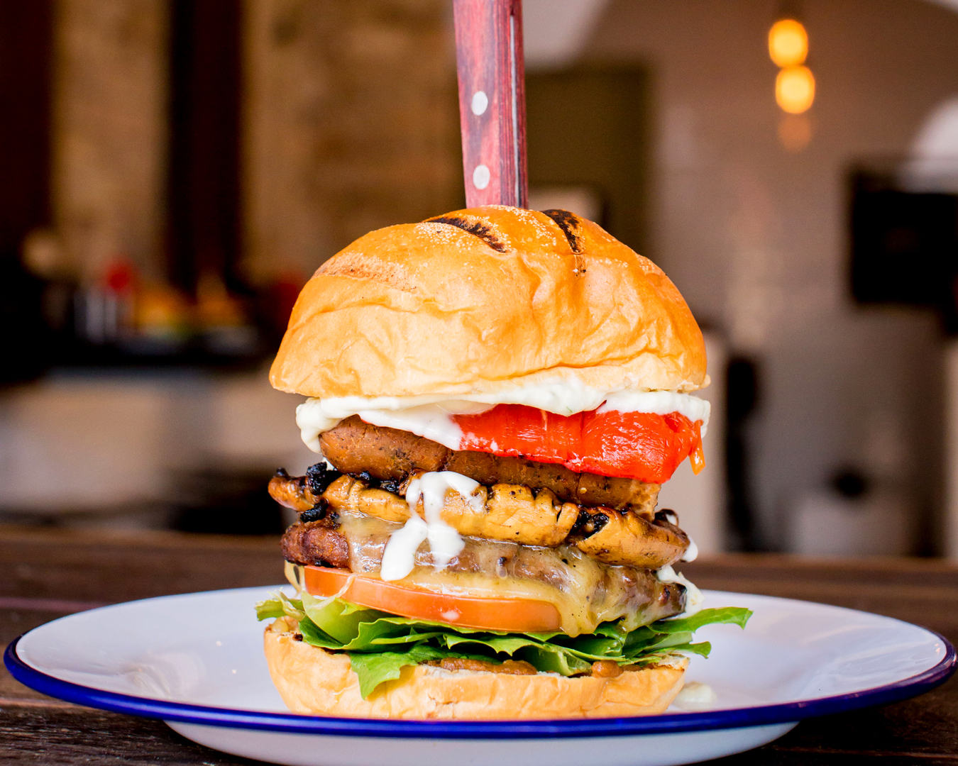 A juicy burger stacked up high.
