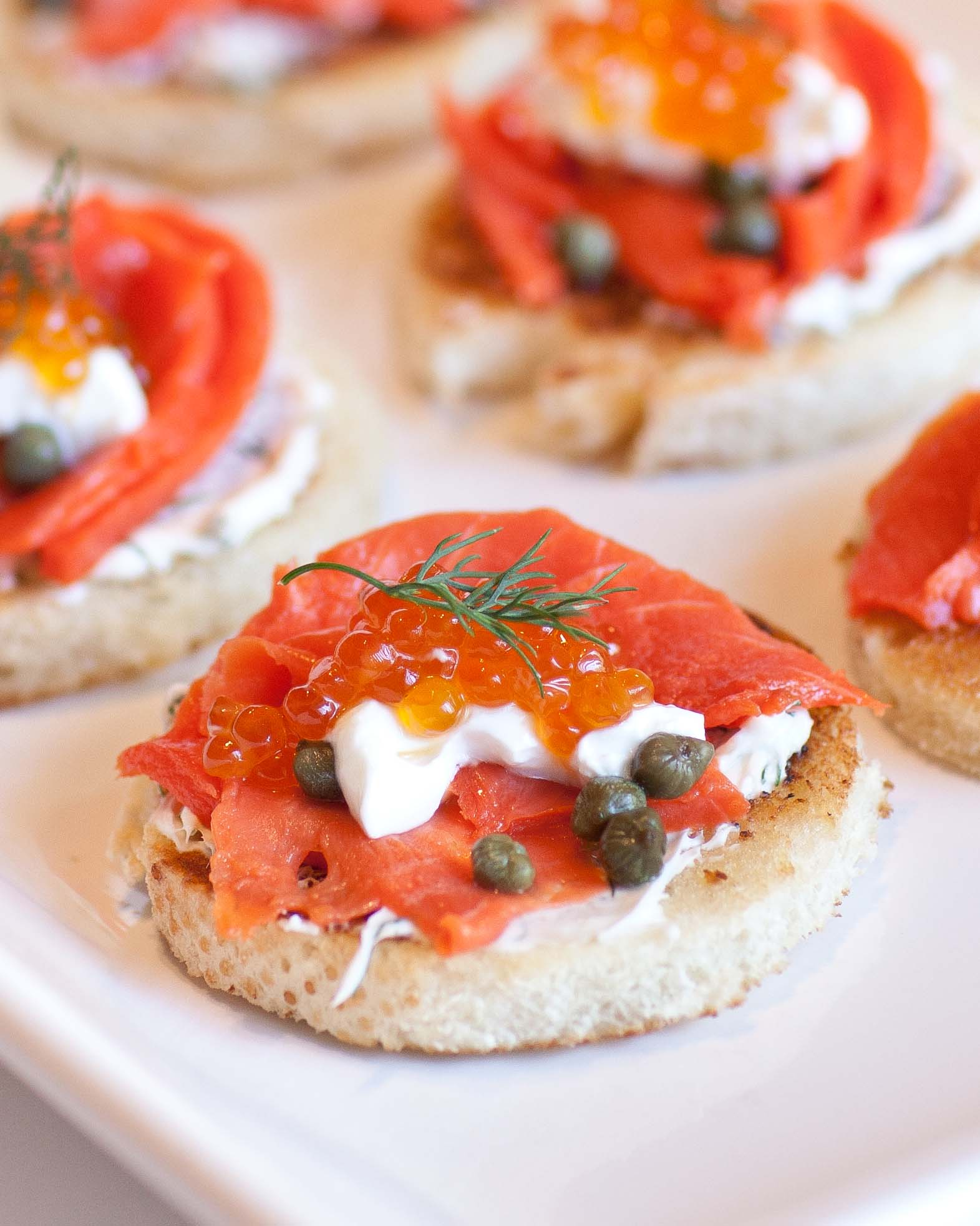 Caviar and smoked salmon canapes topped with capers and dill