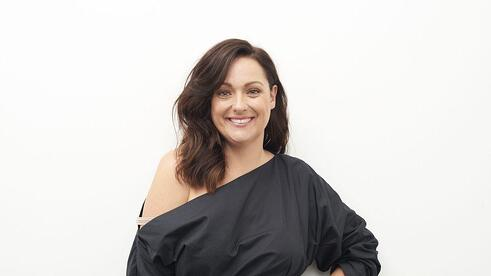 Portrait of Celeste Barber, she is posed in front of a white background and smiling.