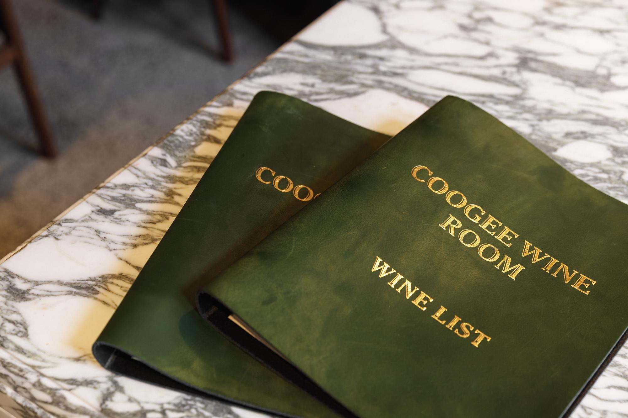 Distil coogee wine room logo branding menu covers green leather